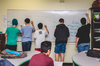 group of students working on the whiteboard