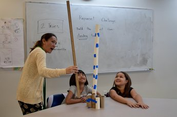 Teacher with students building a tower